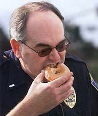 cop eating donuts